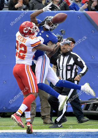 Tavarres King, Marcus Peters. Kansas City Chiefs cornerback Marcus Peters (22) breaks up a pass intended for New York Giants wide receiver Tavarres King (12) during the first half of an NFL football game, in East Rutherford, N.J. Peters was called for pass interference on the play