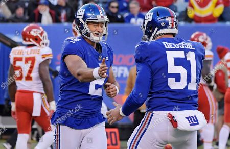 New York Giants kicker Aldrick Rosas (2) celebrates a field goal with teammate Zak DeOssie (51) during the second half of an NFL football game against the Kansas City Chiefs, in East Rutherford, N.J