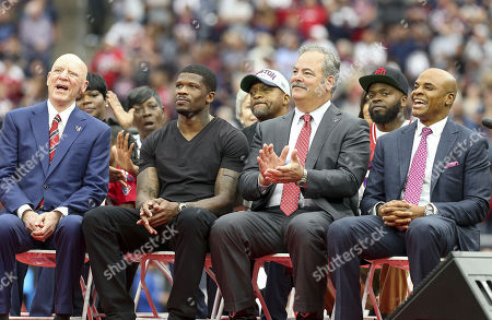 (From L-R) Houston Texans owner Bob McNair, former Houston Texans wide receiver Andre Johnson, Chief Operating Officer Cal McNair, and General Manager Rick Smith during the Ring of Honor induction ceremony of Andre Johnson during the NFL game between the Arizona Cardinals and the Houston Texans at NRG Stadium in Houston, TX