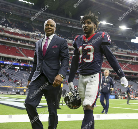 Houston Texans wide receiver Braxton Miller (13) walks with Texans general manager Rick Smith during the NFL game between the Arizona Cardinals and the Houston Texans at NRG Stadium in Houston, TX