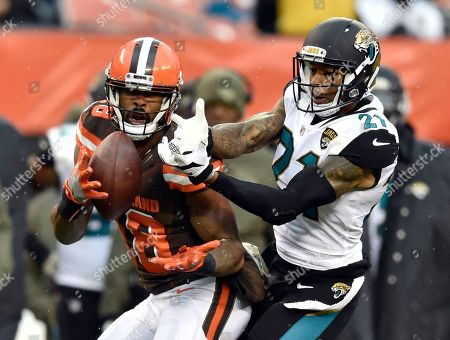 A.J. Bouye, Kenny Britt. Cleveland Browns wide receiver Kenny Britt (18) catches a pass against Jacksonville Jaguars cornerback A.J. Bouye (21) in the second half of an NFL football game, in Cleveland
