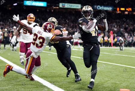 New Orleans Saints running back Alvin Kamara (41) scores a two-point conversion past Washington Redskins free safety DeAngelo Hall (23) to tie the game in the second half of an NFL football game in New Orleans