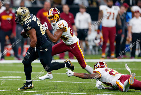 Stock Image of New Orleans Saints running back Mark Ingram (22) rushes for a touchdown past Washington Redskins free safety DeAngelo Hall (23) and cornerback Josh Norman (24) in the first half of an NFL football game in New Orleans