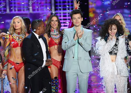 Harry Styles, Leslie Odom Jr, Zhang Liangying and models on the catwalk