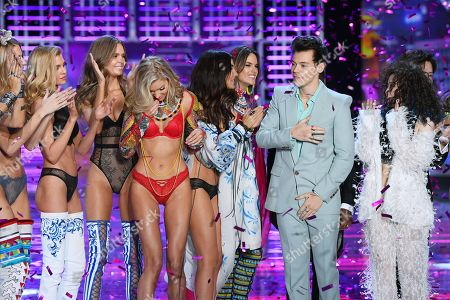 Stock Picture of Harry Styles, Zhang Liangying and models on the catwalk