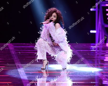 Stock Image of Zhang Liangying performing