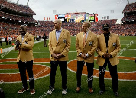 Retired Denver Broncos NFL Hall of Famers from left Terrell Davis, John Elway, Gary Zimmerman and Floyd Little are honored during the first half of an NFL football game against the Cincinnati Bengals, in Denver