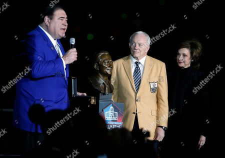 David Baker, Gene Jones, Jerry Jones. David Baker, president an CEO of the Hall of Fame presents Dallas Cowboys team owner Jerry Jones, center, who stands with his wife Gene, right, his HOF ring at half time of an NFL football game against the Philadelphia Eagles, in Arlington, Texas