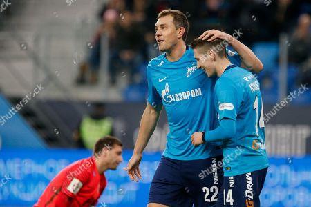 Artem Dzyuba and Daler Kuzyayev of FC Zenit celebrate a goal.