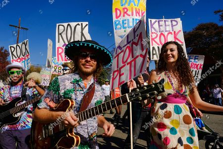 Participants remember late rocker Tom Petty in the 40th annual Occasional Pasadena Doo Dah Parade in Pasadena, Calif