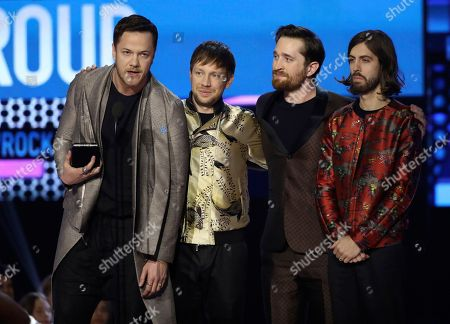 Dan Reynolds, Ben McKee, Daniel Platzman, Daniel Wayne Sermon. Dan Reynolds, from left, Ben McKee, Daniel Platzman, and Daniel Wayne Sermon of Imagine Dragons accept the award for favorite duo or group at the American Music Awards at the Microsoft Theater, in Los Angeles
