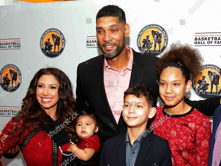 Stock Picture of Tim Duncan Vanessa Macias. San Antonio Spurs and Wake Forest great, Tim Duncan, top, stops for a photo with his girlfriend Vanessa Macias, left, and his children during a National Collegiate Basketball Hall of Fame induction event, in Kansas City, Mo
