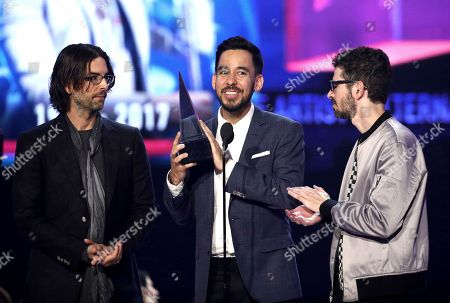 Rob Bourdon, Mike Shinoda, Brad Delson. Rob Bourdon, from left, Mike Shinoda, and Brad Delson of Linkin Park accept the award for favorite artist alternative rock at the American Music Awards at the Microsoft Theater, in Los Angeles