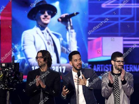 Rob Bourdon, Mike Shinoda, Brad Delson. Rob Bourdon, from left, Mike Shinoda, and Brad Delson of Linkin Park accept the award for favorite artist alternative rock at the American Music Awards at the Microsoft Theater, in Los Angeles. Pictured on screen is late member Chester Bennington