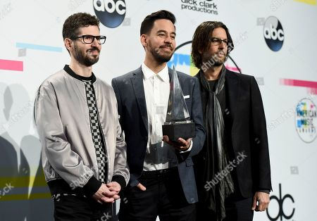 Brad Delson, Mike Shinoda, Rob Bourdon. Brad Delson, from left, Mike Shinoda, and Rob Bourdon of Linkin Park pose in the press room with the award for favorite artist alternative rock at the American Music Awards at the Microsoft Theater, in Los Angeles