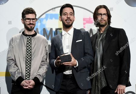 Stock Picture of Brad Delson, Mike Shinoda, Rob Bourdon. Brad Delson, from left, Mike Shinoda, and Rob Bourdon of Linkin Park pose in the press room with the award for favorite artist alternative rock at the American Music Awards at the Microsoft Theater, in Los Angeles