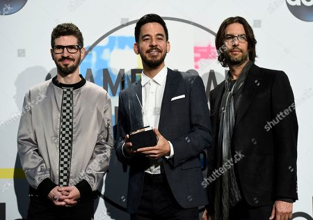 Stock Photo of Brad Delson, Mike Shinoda, Rob Bourdon. Brad Delson, from left, Mike Shinoda, and Rob Bourdon of Linkin Park pose in the press room with the award for favorite artist alternative rock at the American Music Awards at the Microsoft Theater, in Los Angeles