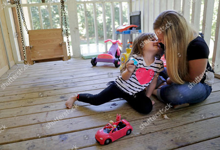 """Whitney Duncan, right, plays with her daughter, Deklyn, 3, while visiting her at the home she's staying at with her grandmother in Jasper, Ga., . Duncan was given a choice after failing a drug screening in 2016; lose her daughter to foster care or temporarily give her to a family member while she enters the county's two-year family drug court program to help with her opioid addiction. """"It took a while for me to be ok with me being an addict,"""" said Duncan of her recovery. """"I can actually dream again and smile at my future instead of not caring about my future. There is one to be had and it's not going to be a jail cell and it's not going to be death"""