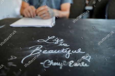 Stock Photo of Whitney Duncan, Dalton Duncan. An inspirational message is written on a desk as Dalton Duncan, seated, attends a class with his wife, Whitney, as part of their mandated enrollment in the county's family drug court program in Jasper, Ga., . The couple was given a choice after failing a drug screening in 2016; lose their daughter to foster care or temporarily give her to a family member while they enter the two-year program to help with their opioid addiction