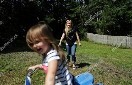 Whitney Duncan, right, plays with her daughter Deklyn, 3, while visiting her at the home she's staying at with her grandmother in Jasper, Ga., . Duncan was given a choice after failing a drug screening in 2016; lose their daughter to foster care or temporarily give her to a family member while she and her husband enter the county's two-year family drug court program to help with their opioid addiction. Across the United States, the opioid epidemic _ and other types of debilitating substance abuse by parents _ is fueling a surge of children being taken into foster care. One of the most dramatic increases has been in Georgia, where the foster-care population soared from about 7,600 in September 2013 to more than 13,300 this spring