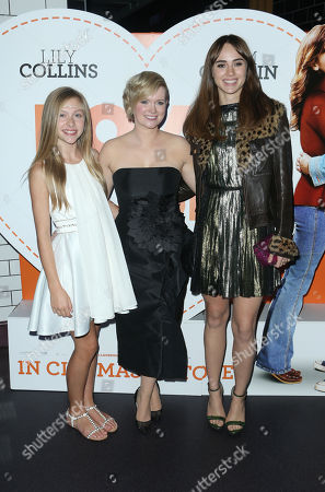 From left, actors Lily Laight, writer Cecelia Ahern and Suki Waterhouse pose for photographers upon arrival at the after party for the premiere of the film Love, Rosie, at Bounce in central London