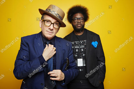 """From left, English singer-songwriter Elvis Costello poses for a portrait with drummer Ahmir """"Questlove"""" Thompson of """"The Roots,"""" in promotion of their upcoming album """"Wise Up Ghost,"""", in New York"""