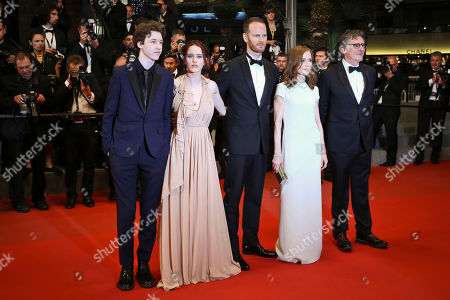 From left, Devin Druid, Rachel Brosnahan, director Joachim Trier, Isabelle Huppert and Gabriel Byrne pose for photographers upon arrival at the screening of the film Louder Than Bombs at the 68th international film festival, Cannes, southern France