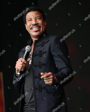Lionel Richie performs on the Pyramid stage at Glastonbury music festival on Worthy Farm, Glastonbury, England. Stevie Wonder, Usher, Lenny Kravitz and Demi Lovato will honor Richie when he is named MusiCares person of the year next year. The Recording Academy said, that John Legend, The Roots and Zac Brown will also pay tribute to Richie at the Feb. 13, 2016, event in Los Angeles