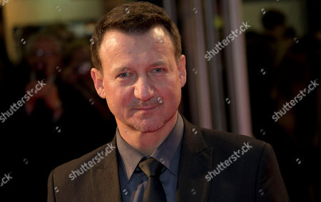 Polish actor Robert Wieckiewicz arrives for the screening of his film, Walesa: Man Of Hope, as part of the 57th BFI London Film Festival, at a central London cinema