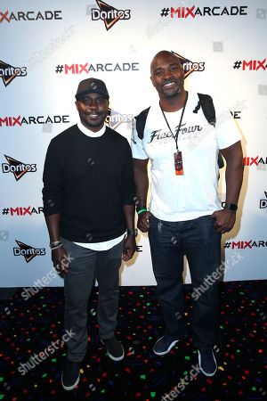 Marshall Faulk, left, and Marcellus Wiley arrive at the Doritos #MixArcade at E3, in Los Angeles