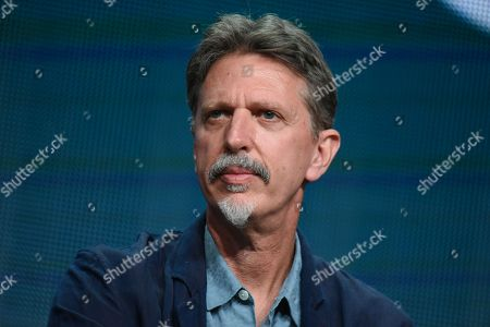 """Executive Producer Tim Kring participates in the """"Heroes Reborn"""" panel at the NBCUniversal Summer TCA Tour in Beverly Hills, Calif. """"Heroes,"""" Kring's mystic, globe-spanning thriller, aired from 2006 to 2010 and then was unceremoniously canceled. Now it's back as """"Heroes Reborn,â?? airing as a 13-episode limited series that debuts with a two-hour opener Thursday at 8 p.m. EDT"""