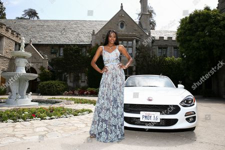 "Eugena Washington, Playmate of the Year, poses at Playboy's 2016 Playmate of the Year Announcement held at the Playboy Mansion in Los Angeles. Hugh Hefner's Playboy Mansion is about to acquire a new owner â?"" the wealthy businessman who lives next door. Representatives for Playboy Enterprises and Daren Metropoulos confirmed Monday, June 6, 2016, that Metropoulos' bid to buy Hefner's man cave is in escrow"