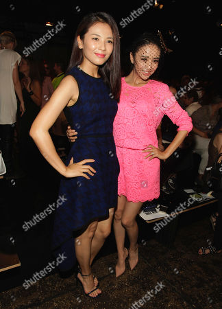 Tong Liya, right and Liu Tao attend the DKNY Spring/Summer 2015 fashion show at Mercedes-Benz Fashion Week on in New York