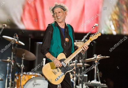 Stock Image of Keith Richards of the Rolling Stones performs at Le Festival d'ete de Quebec in Quebec City.Richards has saluted vocalist Merry Clayton of Gimme Shelter fame and an all-star gathering of jazz musicians has paid tribute to saxophonist Sonny Rollins on the Apollo Theater's stage. It was a showcase for friends stepping up on behalf of honored and absent guests