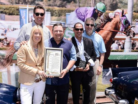 From left to right, Beverly Hills Mayor Lili Bosse, KABC 7 reporter Dave Kunz, Top Assistant Trainer for California Chrome Alan Sherman, Exercise Rider for California Chrome William Delgado, and Chairman of Concours d'Elegance, Bruce Meyer seen at the Rodeo Drive Concours d'Elegance Father's Day event on Rodeo Drive in Beverly Hills, Calif. on