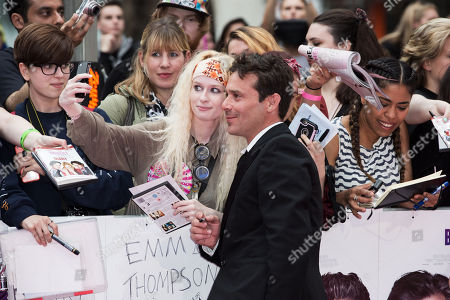 Actor James Callis poses with fans upon arrival at the Premiere of the film â?˜Bridget Jones's Babyâ?™, in central London