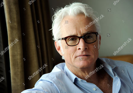 "Actor/director John Slattery poses for a portrait on Thursday, May 1, 2014 in Los Angeles. The ""Mad Men"" actor Slattery makes his directorial debut with ""God's Pocket,"" a independent film based on Peter Dexter's novel about overlapping working class lives, releasing in theaters Friday, May 9. It's also one of the final performances by the late Philip Seymour Hoffman"