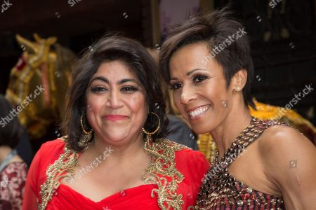 Director Gurinder Chadha, left, and Dame Kelly Holmes pose for photographers upon arrival at the premiere of the musical Bend It Like Beckham in London
