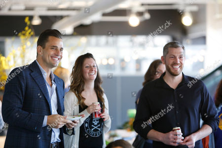 Bill Rancic, left, and Mike Brown, right, attend the Intuit QuickBooks Small Business Big Game viewing party, in San Francisco, CA