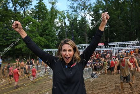 Stock Image of Olympic gold medalist, Summer Sanders, was among the 331 participants who helped Delta Faucet achieve a GUINNESS WORLD RECORDS title for the most people showered simultaneously at the Indiana Warrior Dash event on in Crawfordsville, Ind