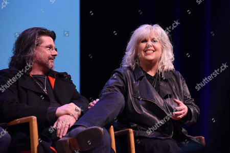 """Stock Image of Show runner Ron D. Moore, left, and costume designer Terry Dresbach speak onstage at the Television Academy's member event, Starz' """"Outlander: From Scotland to Paris,"""" at NYU Skirball Center for the Performing Arts on in New York"""