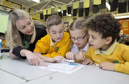 Editorial image of Financial Education Lesson. Leah Ashby-lincoln Bank Staff At The Yorkshire Building Society Teaching Finance At Bursted Wood Primary School Bexleyheath With Pupils ( Left To Right) Charlie Lazell Emily Biggs And Ahmend Rashid All Aged 8.