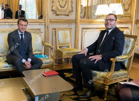 French President Emmanuel Macron, left, attends a meeting with French Socialist party coordinator Rachid Temal at the Elysee Palace in Paris, Monday, Nov.20, 2017