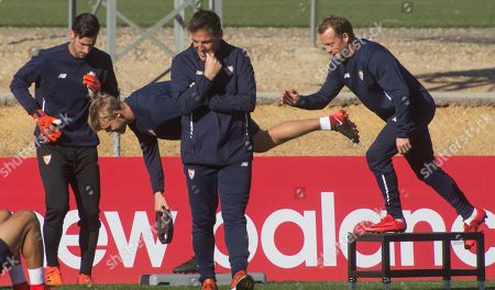 Sevilla FC's head coach, Eduardo Berizzo (C), oversees his players Sergio Rico (L), Simon Kjaer (2L) and Michael Krohn-Dehli (R) during a training session in Seville, Spain, 20 November 2017. Sevilla FC will face Liverpool in a Champions League groupsstage soccer match on 21 November.