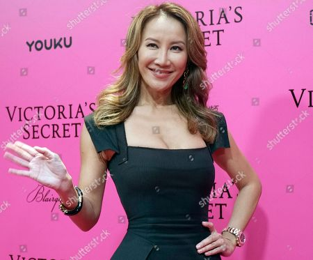Taiwanese-American singer Coco Lee poses for photos during the pink carpet ahead of the Victoria's Secret fashion show at the Mercedes-Benz Arena in Shanghai, China