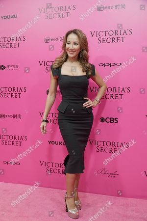 Stock Image of Taiwanese-American singer Coco Lee poses for photos during the pink carpet ahead of the Victoria's Secret fashion show at the Mercedes-Benz Arena in Shanghai, China