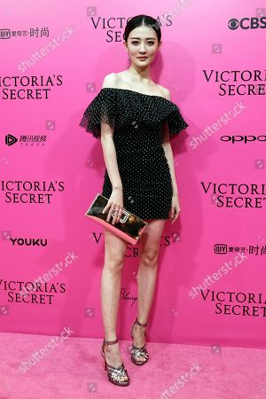 Chinese actress Xu Lu poses for photos during the pink carpet ahead of the Victoria's Secret fashion show at the Mercedes-Benz Arena in Shanghai, China