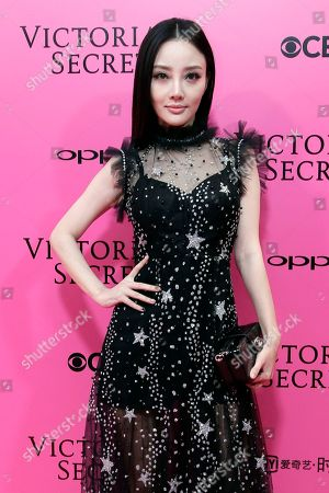 Stock Image of Chinese actress Li Xiaolu, also known as Jacqueline Li, poses for photos during the pink carpet ahead of the Victoria's Secret fashion show at the Mercedes-Benz Arena in Shanghai, China