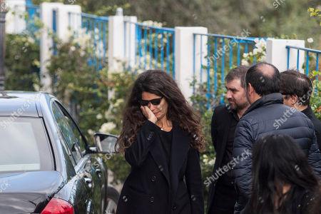 Tunisian-born fashion model Afef Jnifen leaves the residence of Tunisian-born designer Azzedine Alaia before attending his funeral ceremony in Sidi Bou Said, north of the Tunisian capital Tunis, . Azzedine Alaia, an iconoclast whose clingy dresses marked the 1980s and who dressed famous women from Hollywood to the White House, has died at age 77