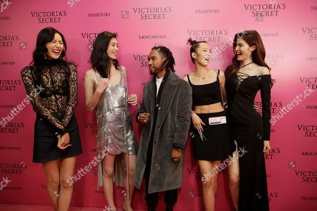 Stock Picture of From left to right, Liu Wen, Xi Mengyao, Miguel Jontel Pimentel, Ju Xiaowen, He Sui pose for a photo, at the after party of the Victoria's Secret fashion show inside the Mercedes-Benz Arena in Shanghai, China